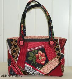 A crazy quilted tote using reclaimed/stash fabric at Sewing Cafe.  Interesting handle attachment.
