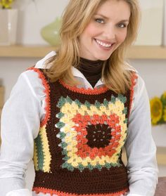 """Granny Motif Vest This was originally published in a collection of """"Rib Ticklers"""" four decades ago! We're sure it's because you can't help but feel like giggling when you see this colorful way to wear a crochet granny square."""