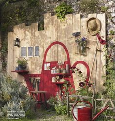 watering can wall in the garden