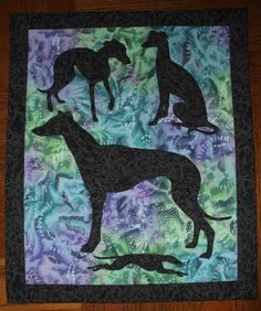 Greyhound applique quilt wall hanging.