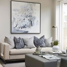 sophiepatersoninteriors : Kitchen seating area in blue taupe and white. Love an upholstered ottoman in faux leather- they make such a practical coffee table for a family home. Wipe clean and no sharp edges!