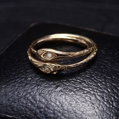 Ouroboros Ring, 10k gold w/diamond, $325.
