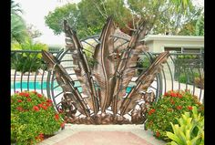 Metal pool gate with palm leaf design. Driveway Gate, Fence Gate, Fences, Wrought Iron Decor, Wrought Iron Gates, Metal Pool, Garden Gates And Fencing, Gate Way, Door Gate Design