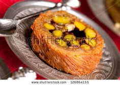 Burma Baklava on silver plate, traditional Turkish sweet made with shredded fillo dough wrapped around a mountain of Turkish pistachios. by ...
