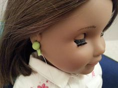 Here's a great tutorial for making Earbuds for you doll. Lots of pictures to illustrate this quick and easy DIY project