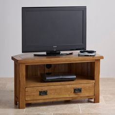 Rustic Oak Corner TV + DVD Cabinet is designed for modern Plasma television sets. Handcrafted from A-grade solid oak with a traditional, home-spun styling.