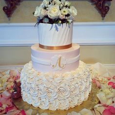 Cindy's Cakery // buttercream rosettes wedding cake// monogram // floral wedding cake topper //  pink gold and white wedding // www.cindyscakery.com #williamsburgweddings // williamsburg floral and gifts // Two Rivers Country Club