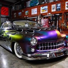 "This is about the only use of ""Chrome illusion"" paint that I really like!  The Merc is Kool, and the '57 Cadillac caps and Whitewalls, too!"