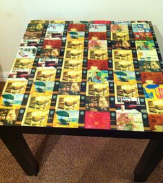 DIY Starbucks gift card side table. I took all my old Starbucks gift cards (and asked the store for some too), glued them to the top of a cheap table, and POOF...a cool, retro, side table for the home.