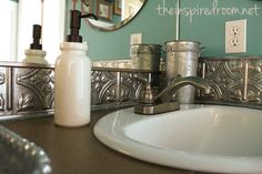 Turquoise bathroom makeover - board and batten walls and faux tin ceiling tile as back splash. Love this bathroom! #diy