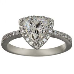 Antique trillion setting, love the color and cut of the stone.