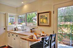 Cottage Kitchen with Flush, Flat panel cabinets, Drop-In Sink, Breakfast bar, Crown molding, Limestone Tile, Hardwood floors