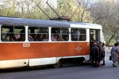 Moscow, line 45, 1986. Ascending and descending passengers having to use the same entrance on a two-door Tatra tramcar