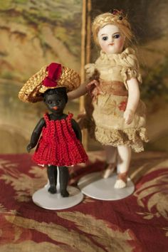 Tiny black doll by Gebruder Kuhlenz, with white doll .....