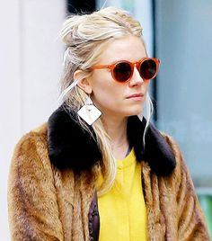 See How These Stylish Ladies Accessorize via @WhoWhatWear.  Hate the fur coat but love this look.