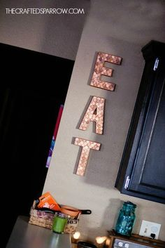 "Make your money into wall art with these <a href=""http://www.thecraftedsparrow.com/2012/01/loose-change.html"" target=""_blank"">block letters</a>."