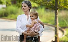 "Melissa McBride, otherwise known as #TheWalkingDead's cookie-bribing undercover badass Carol (holding Judith in a scene on-set), talks to EW about the ""frightening"" new group known as the Wolves. ""We're going to put some of the pieces together in season 6 and figure out more about who they are and why they are the way they are and what they want,"" she says. Image Credit: Gene Page/AMC"