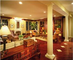 A soffit, supported by collumns and a row of diamonds on the floor define this open floor plan.
