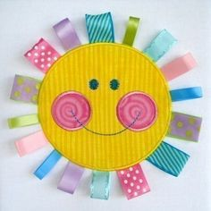 Applique sun with taggies