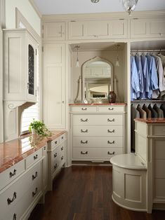 Exciting Custom Linen Cabinet With Hamper: Traditional Dressing Room Closet With A Built In Dresser And Laundry Hamper And Custom Fabrics Countertops