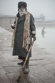 "A sadhu in a foggy Varanasi (India).   Visit http://robertopazziphotography.weebly.com, subcribe to the newsletter and download the ebook ""Streets of the World"" as welcome gift!  Web Site: http://robertopazziphotography.weebly.com/ Facebook: Roberto Pazzi Photography Instagram: Roberto_Pazzi_Photography"