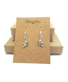 Witch Earrings, Witch Earrings, Halloween Jewellery, Halloween Jewelry, Witch Jewellery, Halloween Costume Jewelry These are a cute pair of charm earrings shaped like witches. They would make a perfect addition to a Halloween Costume!The charms are Silver Plated, and measure approx half inch from top to bottom.The earrings are on silver plated hooks and dangle down about 2 inches from the earlobe.A rubber back will also be provided to hold them in place.The earrings will arrive, in a g...