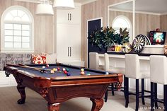Dark-stained wood pool table
