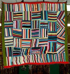 Dazzling, stripes in squares quilt, African American. ca. 1955-1965.  Olean Public Library