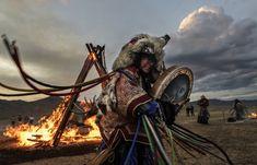A shaman beats her drum