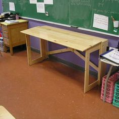 http://www.instructables.com/id/MORE-NOMAD-FURNITURE-A-Folding-Desk/
