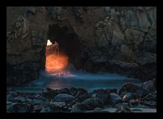 Fire in the Hole! Liquid fire pours through the archway in Keyhole Rock on Pfeiffer Beach in Big Sur  Pfeiffer Beach, with its purple sand, IS down Sycamore Canyon Road at mile marker Mon 45.64. It is not a state park, but on Los Padres National Forest land.