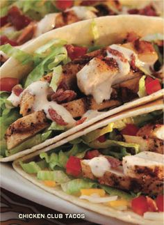Chicken Club Tacos  Two tortillas with grilled chicken, applewood smoked bacon, tomatoes, cheese, lettuce and chipotle pesto ranch dressing.