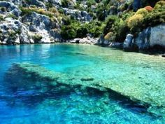 The underwater ruins at Kekova, Turkey.  A submerged port dating back to the 5th century BC was buried by a series of earthquakes over the years.  Through the gorgeous turquoise waters, you can clearly see the remains of building and staircases to nowhere.  You can even snorkel through the ruins!  Added to bucket list!!!