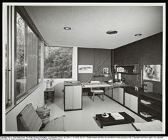 SHULMAN, JULIUS (1910-2009) [Mills House - interior office, Los Angeles, CA. 1960. Donald Polsky architect]. Note the supporting brace, part of the mechanical faberic of this hillside house, is exposed as a feature (behind the desk).