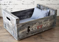 "**Recycled cat bed.** Made of wooden fruits crate, hand painted and varnished with acrylic paint, decoupaged, applied transfer labels. It comes with a 3 cm (1.2"") thick pad of foam and small..."