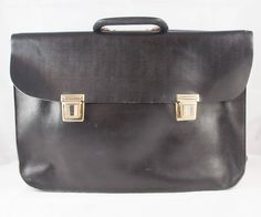 a790a7fd38 Sac en cuir noir vintage avec des fixations métalliques. Cartable - Sac Lap  Top -