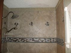ceramic tile shower stall with slate mosaic border and shower floor 2