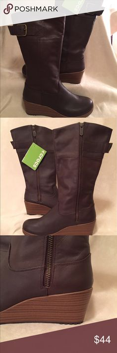 Crocs 'A-Leigh'  Boot in Brown- New With Tags Crocs 'A-Leigh' Boot- New With Tags- Sold out Style in this size --Shaft is approx 13 inches up from arch--- 17 inches around calf-- 2.5 inch heel-- Say what you want about Crocs... But if you cannot ruin real leather/suede in snow and rain and also cannot walk in 3+ inch boots in the snow & rain... these are for you! ( All of us!!$$).   They are cute, weather Proof, and Check out the bottoms!! Super durable for any weather. Will fit 8 to 8.5…