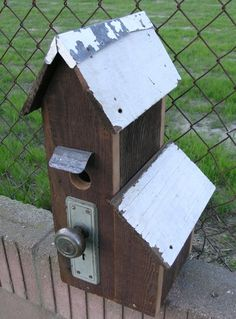 Birdhouse made of reclaimed wood and doorknob.