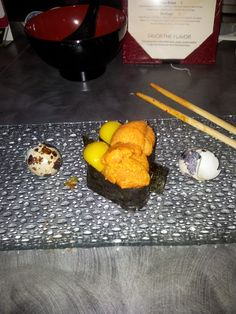 "My first sea urchin..if it weren't for Anthony Bourdain practically having the big ""O"" everytime he has it, I probably wouldn't have tried it...it was AMAZING! and the quail egg was perfect with it"
