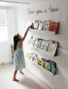 A quick and easy project to transform a boring wall into the perfect playroom book storage spot! Great fo A quick and easy project to transform a boring wall into the perfect playroom book storage spot! Great for storing all of those picture books! Playroom Design, Playroom Decor, Playroom Ideas, Nursery Wall Decor, Toddler Playroom, Kids Play Rooms, Ikea Kids Playroom, Children Playroom, Cool Kids Rooms