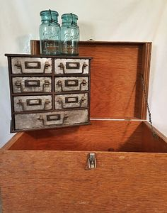 Awesome mid-size storage box and sweet little industrial cabinet...mason jars!
