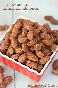 Slow Cooker Cinnamon Almonds on SixSistersStuff.com - these make your house smell amazing and taste just like the ones you can buy at the mall!