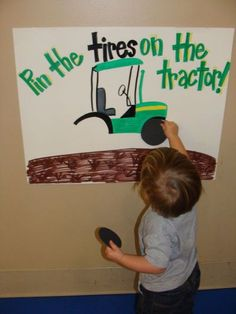 Pin the tires on the tractor is a fun John Deere birthday game.  See more John Deere birthday party ideas at www.one-stop-party-ideas.com