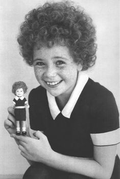 Aileen Quinn | Aileen Quinn holds up an Annie doll modeled after her likeness