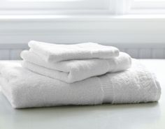 Towel Set – The Distinguished Guest. A towel set consist of a hand towel, hand towel and face cloth. Provide all three for a chic look! #airbnb #hospitality