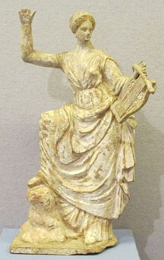 Terracotta figure from Tanagra,4th century BC.
