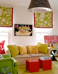 Obviously not your color scheme but like the roman shades piped in contrasting color