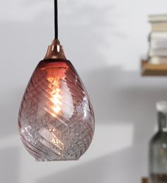 Made from mouth-blown glass, the light shade is completely smooth on the outside with a soft optical finish interior that creates a gentle refraction through the glass. £29 | MADE.COM