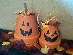 Cute and easy fall decorations.  Terra cotta pots turned upside down,  stencil or free hand the mouth and face. Add a stick thru the hole in the pot and tie raffia in a bow.